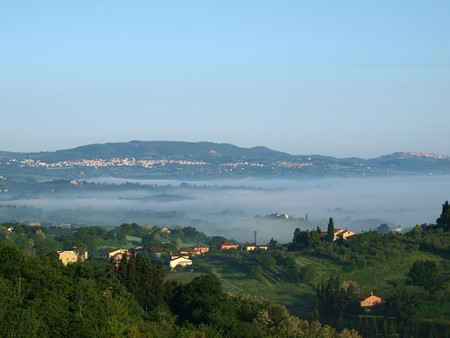 Fabulous landscape of the foggy morning in Tuscany. The\ valley between Montepulciano and Chiusi