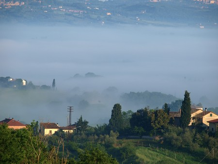 valdorcia: Fabulous landscape of the foggy morning in Tuscany. The valley between Montepulciano and Chiusi