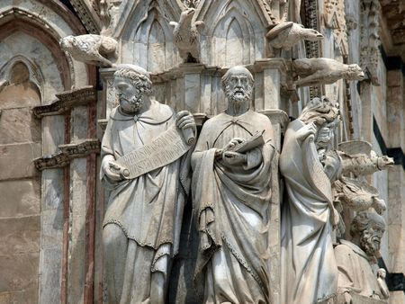 Architectural details of Duomo facade - Siena,Tuscany,Italy. The Duomo of Siena, which was built in the 12th and 13th centuries, is one of the prettiest churches in Gothic style in Italy photo