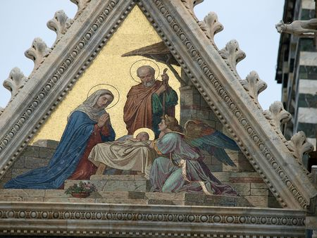 Siena - Duomo facade.The smaller mosaic, Nativity of Jesus by Alessandro Franchi.