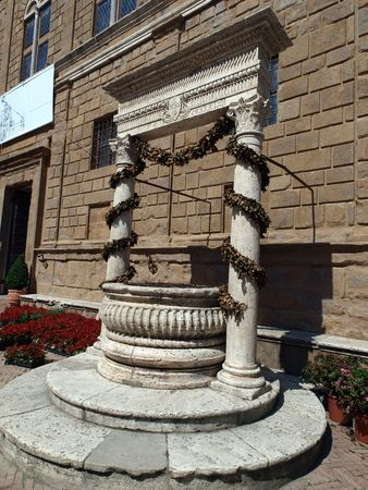 Pienza - the old well on the Cathedral square photo
