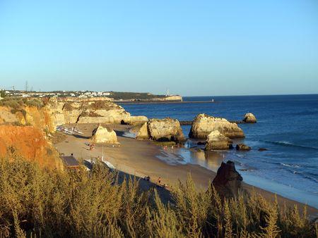 rocha: A section of the idyllic Praia de Rocha beach on the southern coast of the Portuguese Algarve region.