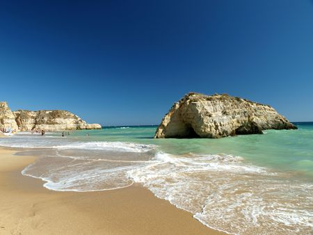A section of the idyllic Praia de Rocha beach on the southern coast of the Portuguese Algarve region. Stock Photo