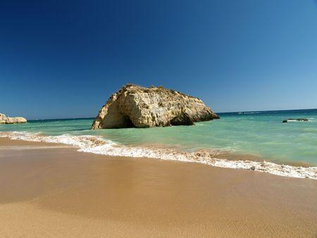 rocha: A section of the idyllic Praia de Rocha beach on the southern coast of the Portuguese Algarve region. Stock Photo