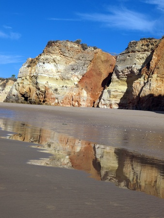 Colourful rocks and wonderful sands on the Algarve coast in Portugal  photo