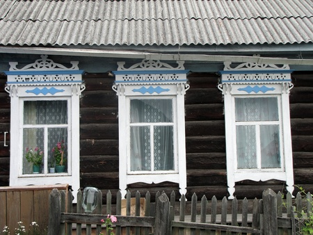 carved windows of old wooden house.  photo