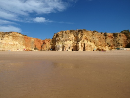 Colorful rock cliffs of the Algarve in Portugal photo