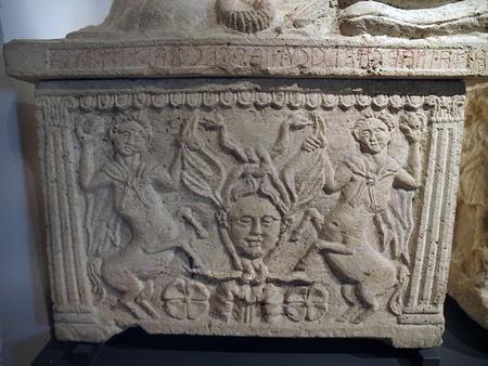 etruscan: Etruscan gravestones . Alabaster cinerary urns from Montepulciano ,Poggio alla sala. 3-2 centuries B.C. On the coffin , a Gordon mask between two centaurs.