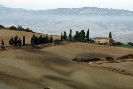 The hills around Pienza and Monticchiello  just after sunrise. tuscany, Italy. Stock Photo - 10678080