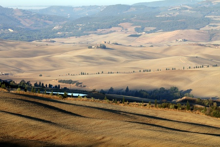 The hills around Pienza and Monticchiello  just after sunrise. Tuscany, Italy. Stock Photo - 10682932