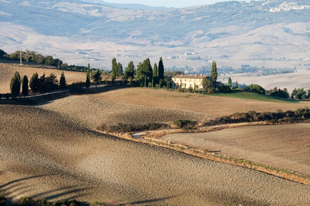 The hills around Pienza and Monticchiello  just after sunrise. Tuscany, Italy. photo