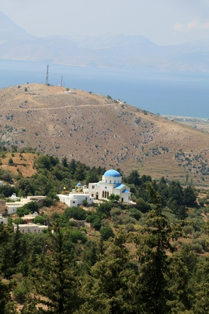 Typical Greek Orthodox church with blue domes on Kos Stock Photo - 10942786