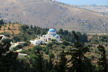 Typical Greek Orthodox church with blue domes on Kos photo