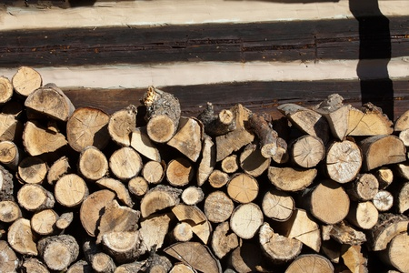 firewood arranged by the country cottage  photo