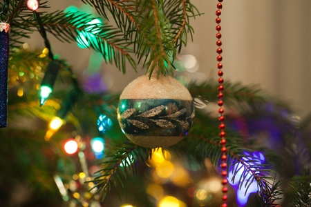 Christmas bauble on christmas tree photo