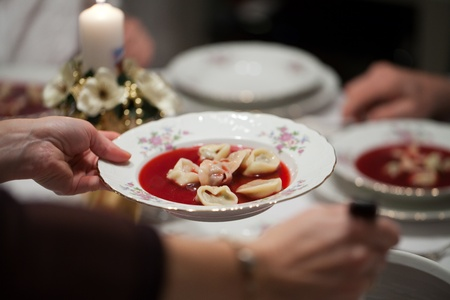 Red borscht with mushroom ravioli for christmas eve