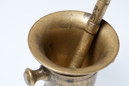 brass mortar and pestle  isolated on white photo