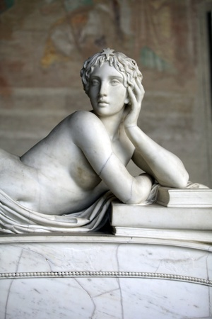 Pisa Campo Santo: Detail from Tomb of Ottaviano Fabrizio Mossotti (1791 - 1863), italian mathematician, physicist and astronomer. The reclining figure represents the Science.  Gentle beauty immortalised in marble