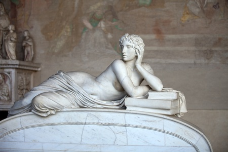 Pisa Campo Santo: Detail from Tomb of Ottaviano Fabrizio Mossotti (1791 - 1863), italian mathematician, physicist and astronomer. The reclining figure represents the Science.  Gentle beauty immortalised in marble  Editorial