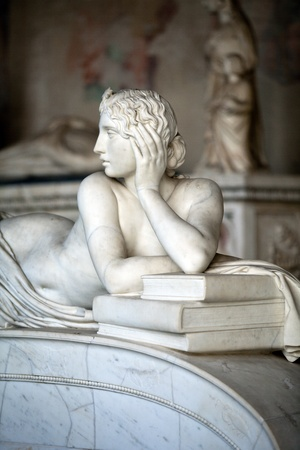 women subtle: Pisa Campo Santo: Detail from Tomb of Ottaviano Fabrizio Mossotti (1791 - 1863), italian mathematician, physicist and astronomer. The reclining figure represents the Science.  Gentle beauty immortalised in marble  Editorial