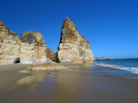 region of algarve: A section of the idyllic Praia de Rocha beach on the southern coast of the Portuguese Algarve region. Stock Photo