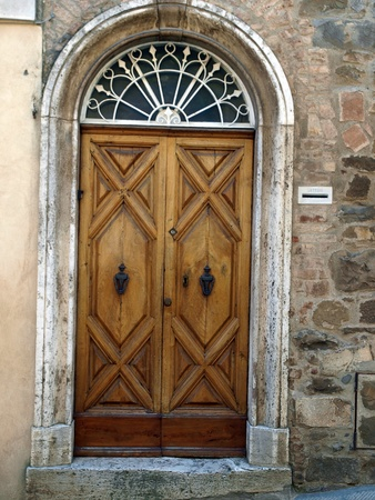 wooden residential doorway  in Tuscany. Italy Stock Photo - 12345355