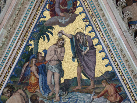 orvieto: Orvieto - Duomo Facade. The biblical scene of Jesus baptism, a mosaic of the left portal of the cathedral