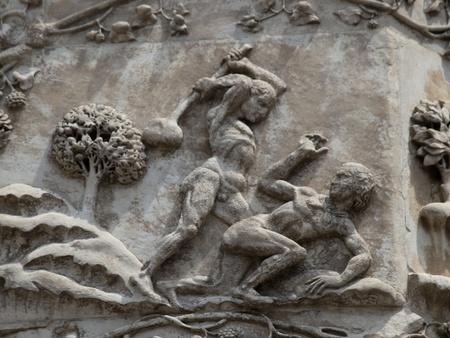 Orvieto - Duomo facade. The first pillar: scenes from Genesis.Kaim kills Abel Stock Photo - 12591597