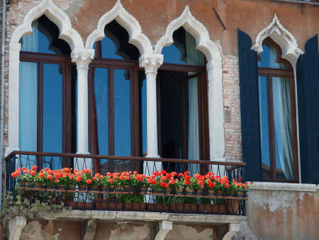 archtecture: Venice - the beauty of Venetian windows decorated with flowers Editorial