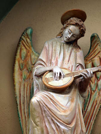 Sculpture of an angel with mandolin. Chiusi , Tuscany, Italy Stock Photo - 12616751