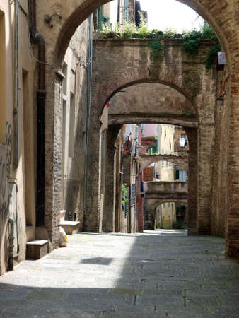 The picturesque streets of the historic center of Siena Stock Photo - 12616775