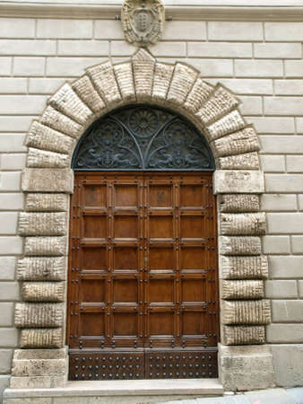 wooden residential doorway  in Tuscany. Italy Stock Photo - 12613421