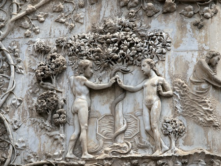 adam eve: orvieto - Duomo facade. The first pillar: scenes from Genesis.Eve offers the forbidden fruit to Adam. Stock Photo