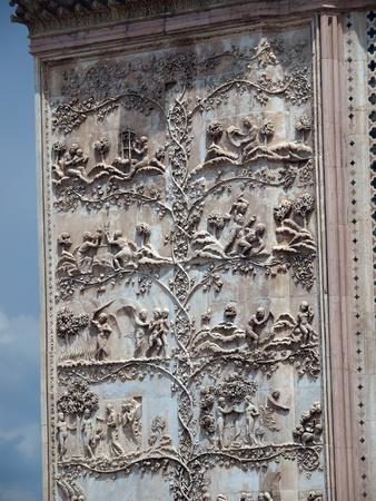 Orvieto - Duomo facade. The first pillar: scenes from Genesis Stock Photo - 12768775