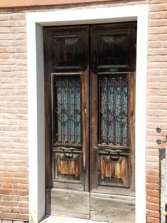 Old wooden door - Murano island photo
