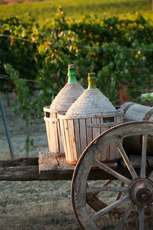 A cart loaded with wine bottles Stock Photo