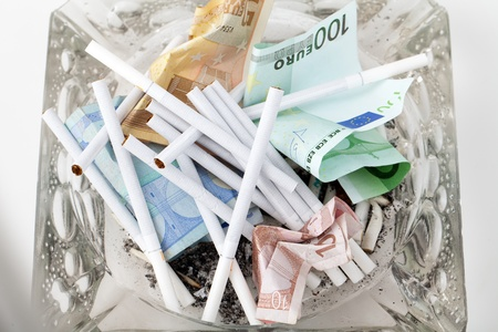 harmful and costly addiction Stock Photo - 13343339
