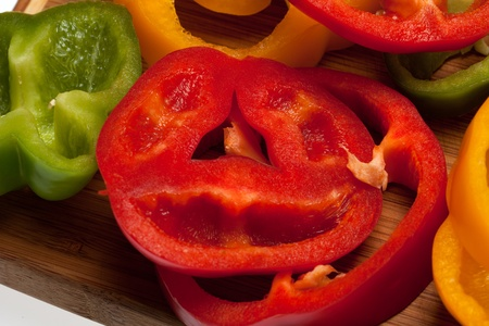 close up of red, yellow and green peppers photo