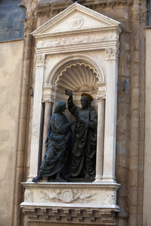Florence - Church of Orsanmichele. Christ and St. Thomas photo