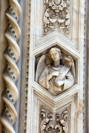 carrara: Florence - elaborate decorations of the portal on the Duomo facade