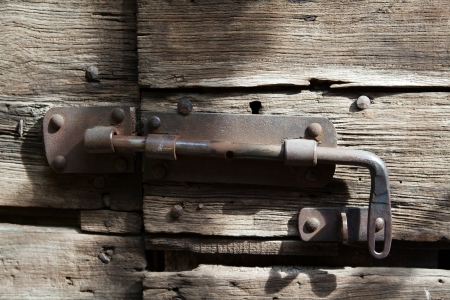 closed woodenl door with lock Stock Photo - 14252941