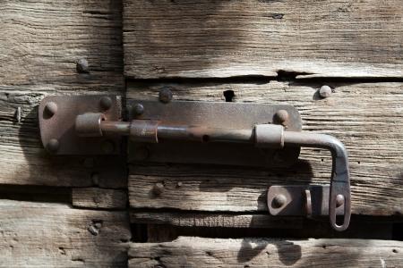 closed woodenl door with lock  photo