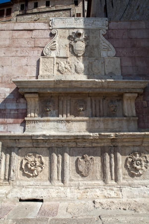 Stone fountain. Assisi. Umbria photo