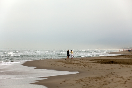 a morning walk on the beach photo