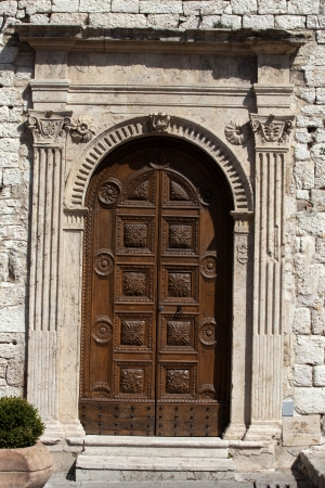 wooden residential doorway in Tuscany.  photo