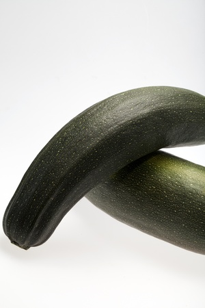 Fresh vegetable courgette. Isolated on white  photo