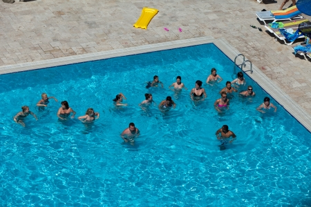 People are doing water aerobic in pool