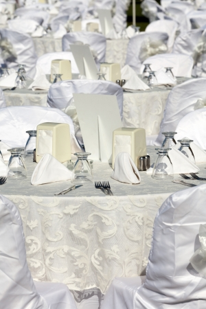 Empty served restaurant table with white tablecloth
