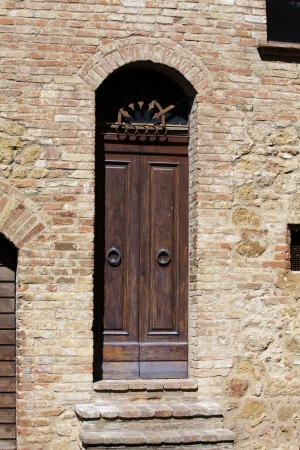 wooden residential doorway in Tuscany  Italy  photo