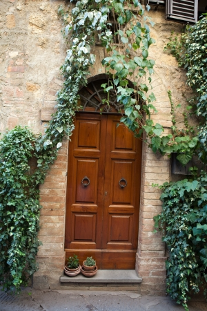 wooden residential doorway in Tuscany. Italy Stock Photo - 15045142